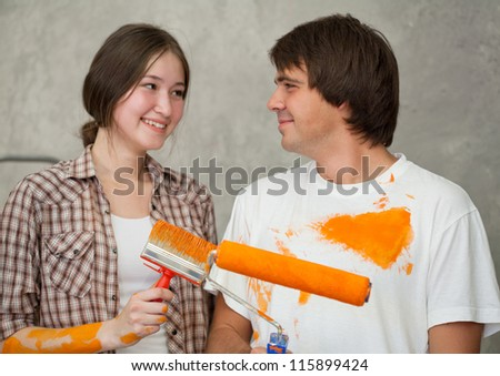 Playful couple looking at each other while remodeling - stock photo
