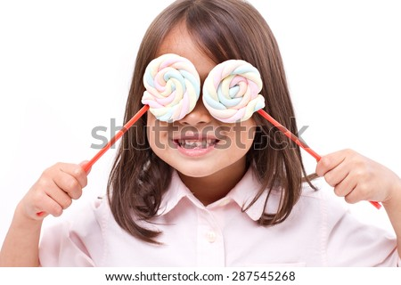 playful cute little girl posing with sweet pastel color marshmallow - stock photo