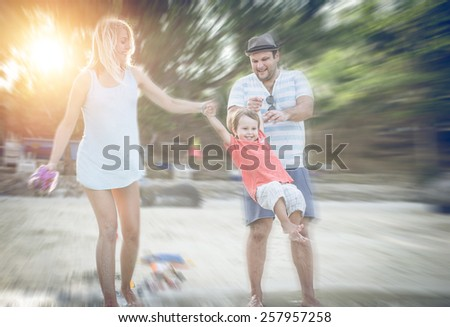 playful family on the beach. concept about family, vacation and leisure - stock photo