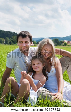 playful family on the meadow