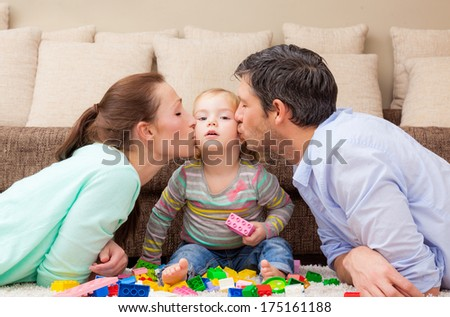 playful family with child at home - stock photo