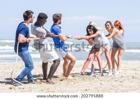 playful friends on the beach - stock photo