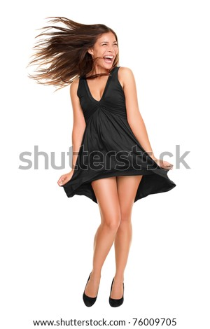 Playful funny woman excited standing in black dress. Beautiful happy mixed race Asian Caucasian model isolated on white background in full body. - stock photo