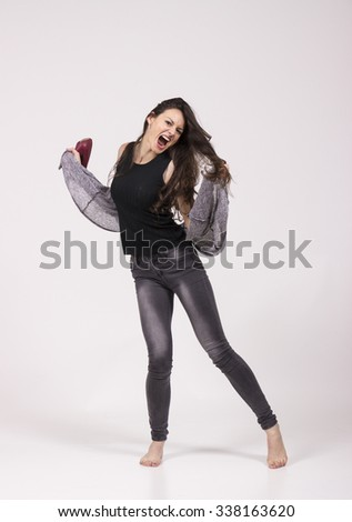 playful girl, dancing in studio freestyle, wild. white background