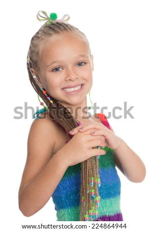 Playful girl holding her dreadlocks. Girl is six years old.  - stock photo
