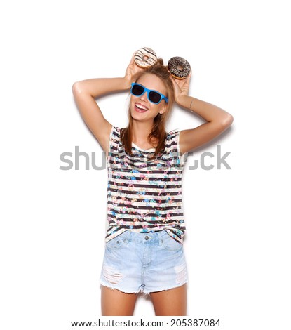 Playful girl in sunglasses holding donuts on her head. Woman showing mouse. White background, not isolated - stock photo