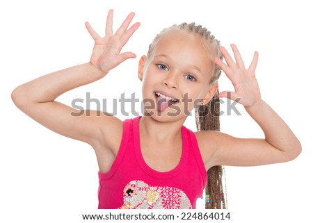 Playful girl jokingly stuck out her tongue. Girl six years. - stock photo