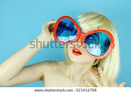 Playful girl with funny glasses, Happy naughty blonde hair woman with Large funny glasses. - stock photo