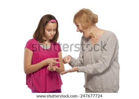 Playful granddaughter and grandmother isolated on white background - stock photo