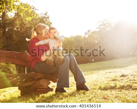 Playful grandmother spending time with his grandson in park on sunny day - stock photo
