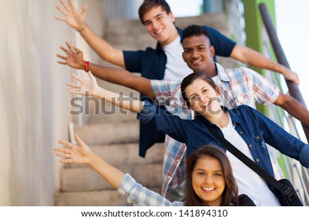 playful group of cheerful teenage high school students - stock photo