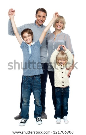 Playful kids with parents over white background, raising hands. - stock photo