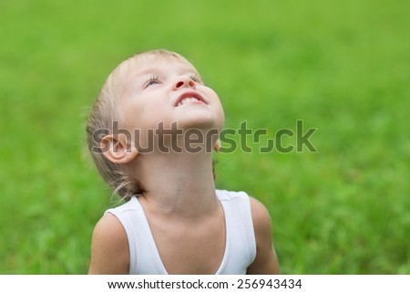 Playful little boy looking up. Boy three years. - stock photo