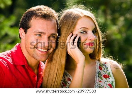 Playful love couple smiling in summer park