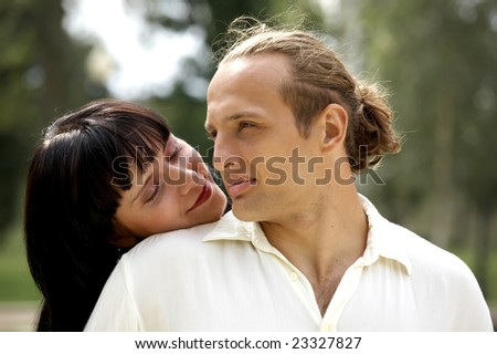 Playful love couple smiling outdoors