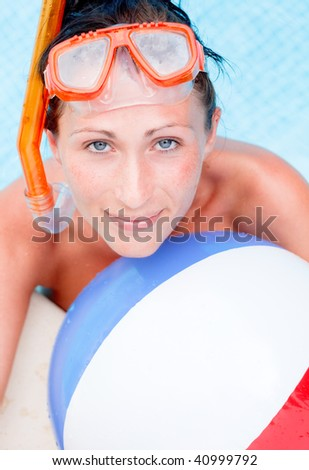 Playful pool vacations holiday woman with diving ball equipment