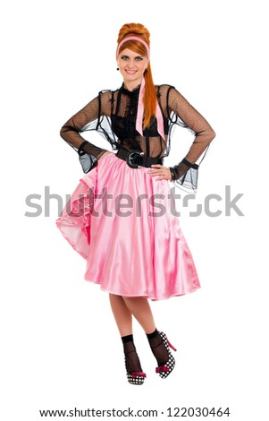 Playful pretty young woman in a pink skirt. Isolated