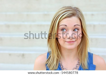 Playful Professional Blonde Professional Business Woman Smiling and Looking to the Side - stock photo
