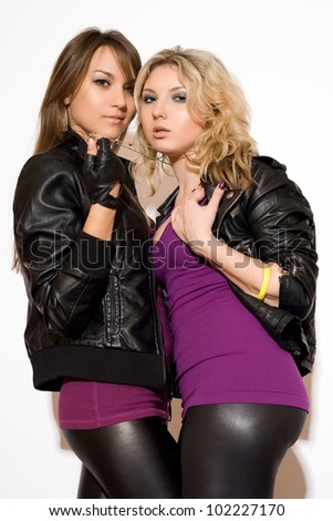 Playful sexy blonde and brunette girl. Isolated - stock photo