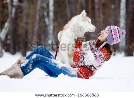 playful woman with dog   - stock photo