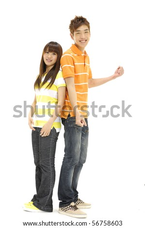 Playful young couple standing