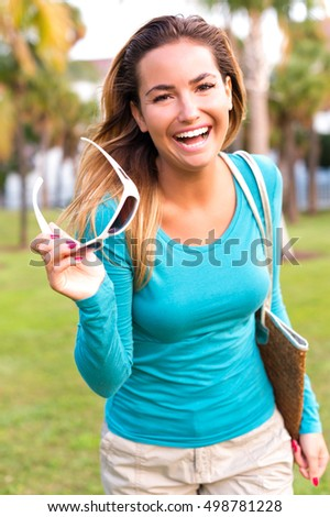 Playful Young Woman in Park
