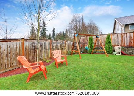 Playground area in the house backyard with swings . Northwest, USA