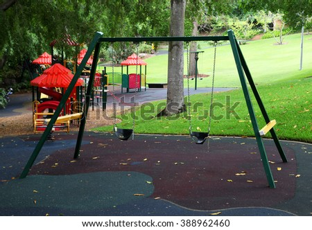 Playground equipment in garden setting
