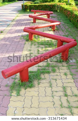Playground equipment made from wood and paint with red
