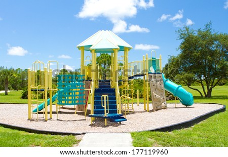 Playground equipment on a warm summers day - stock photo