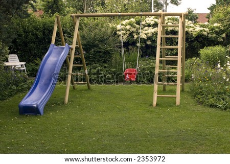 Playground in garden with swing.
