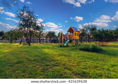 playground of children's near a house - stock photo