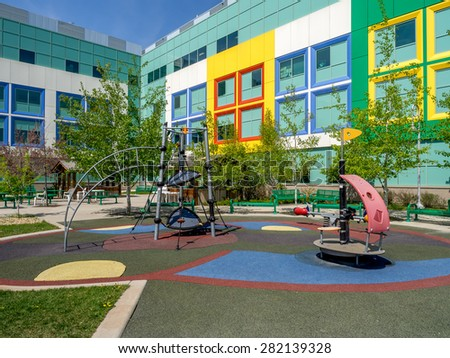 Playground outside a colourful children's hospital. - stock photo