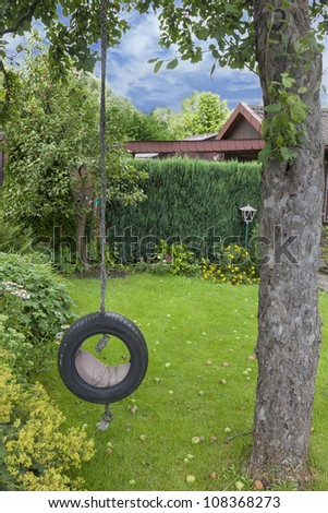 playground with a self made garden swing hanging on a tree