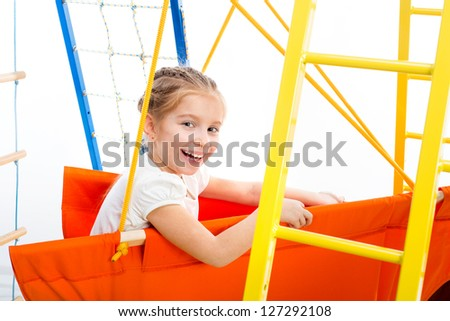 playground with little girl on a white background - stock photo