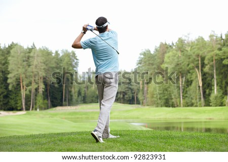 Playing a man on the golf course - stock photo