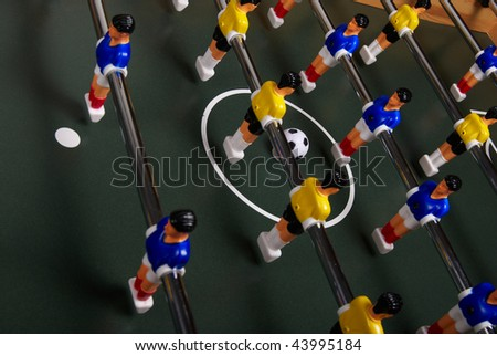 Playing a table foosball game