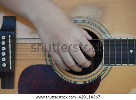 playing acoustic guitar, close up body guitar