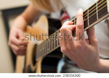 Playing acoustic guitar close up. selective focus image - stock photo