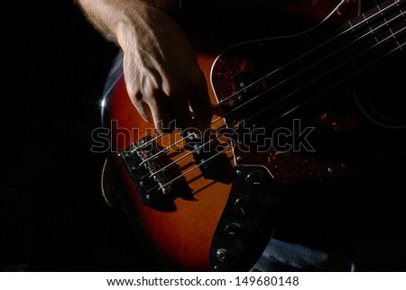 Playing an fretless bass guitar