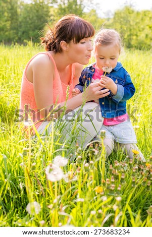 playing and explaining nature to child