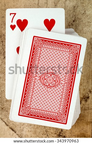 Playing card deck with seven of hearts