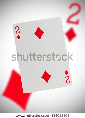 Playing card with a blurry background, two