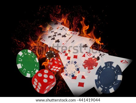 Playing cards and casino chips on fire. poker concept. - stock photo