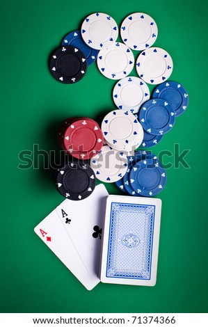 playing cards and chips on a green background - stock photo