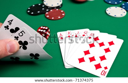 playing cards and chips on a green background