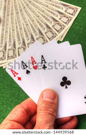 Playing cards and money - stock photo
