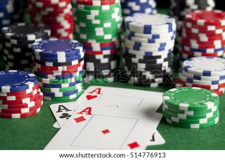 Playing cards and poker chips on green table