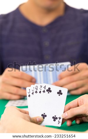 Playing cards closeup of hands holding deck cuarenta traditional Ecuadorian game selective focus