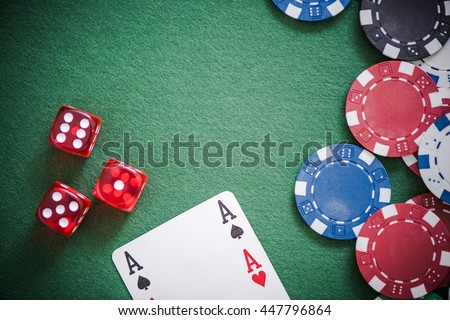 playing cards,dices and poker chips from above on green poker table - stock photo
